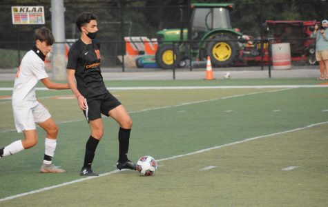Senior Hadi Jawad tries to get by a Belleville defender. Jawad scored two goals in the game to help the Pioneers secure the 9-1 victory.